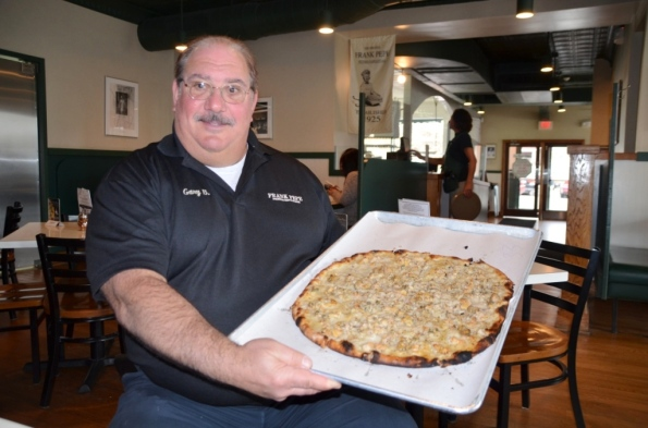 Gary, Frank Pepe's grandson, holding the #1 Pizza in US - White Clam pizza