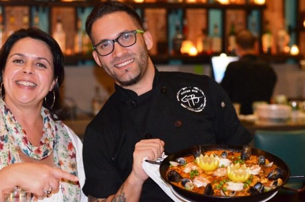 Chef Fernando Gomez presenting Paella