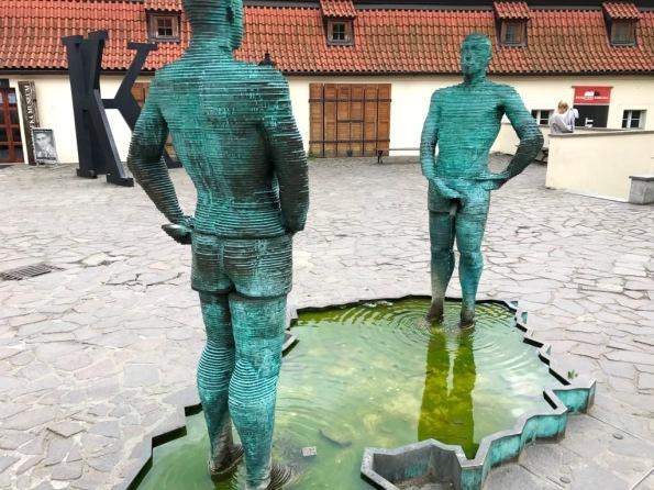 Peeing man sculpture at Kafka Museum