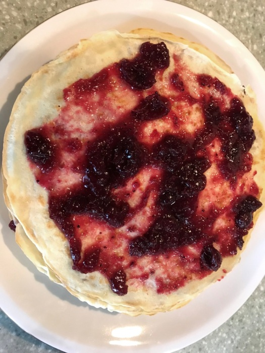 Crepes with cranberry sauce